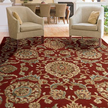 Oriental-inspired arabesques and blossoms grace this utterly elegant area rug in regal hues of sky, white, rose, olive, russet and pale gold.